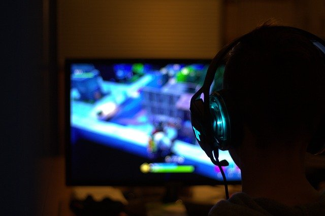 A person sitting in front of a television screen