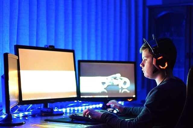 A person standing in front of a computer screen